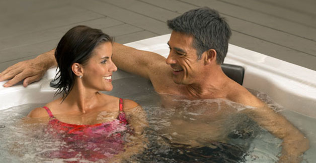 Climacube couple in hot tub